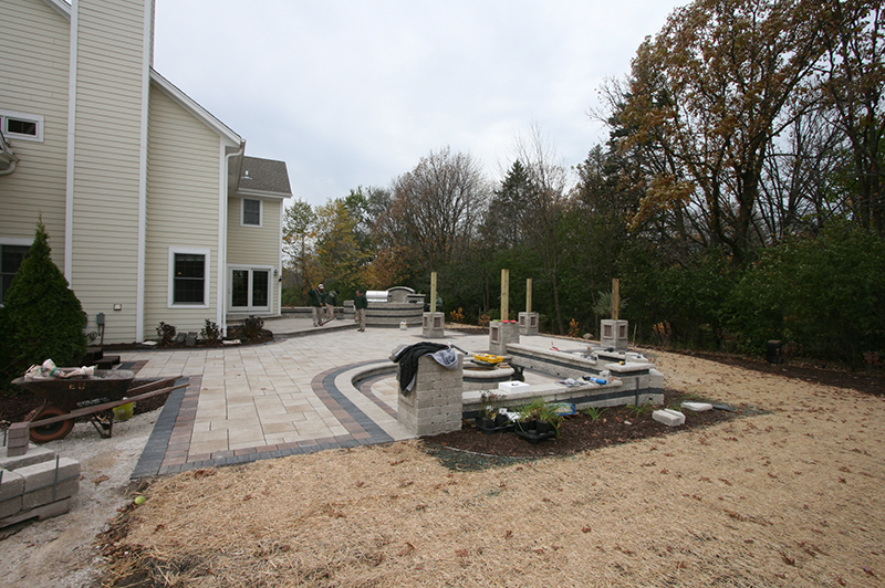 outdoor kitchen, brick paver patio, seating wall, firepit